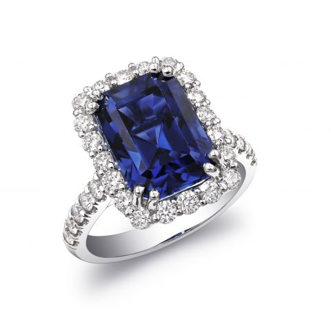 Natural Blue Sapphire 7.91 carats set in 18K White Gold Ring with Diamonds / AGTA Report